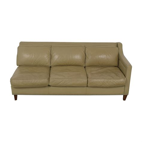 The chesterfield sofa is known for its quilted or tufted style. 90% OFF - Elite Leather Company Elite Leather Company Beige Single Arm Three-Cushion Sofa / Sofas