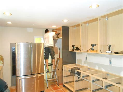 how to hang kitchen cabinets putting cabinets in kitchen bar cabinet