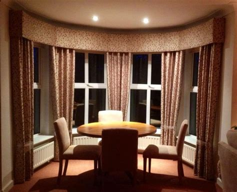 curved bay window dressed  padded pelmet  curtains