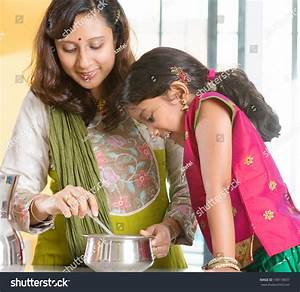 Asian Family Cooking Food Together At Home. Indian Mother ...