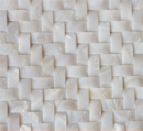 white of pearl arched tile backsplash herringbone
