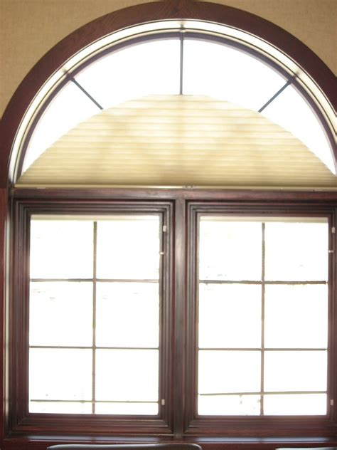 fan shaped window shades window fashions duette honeycomb shades easy view arch