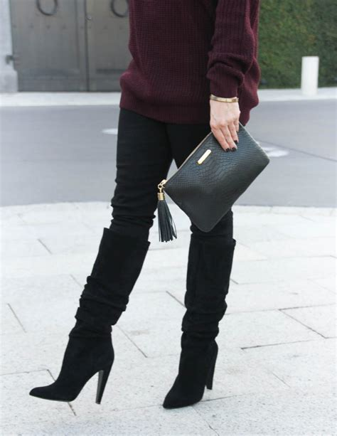black slouchy boots cold shoulder sweater lady