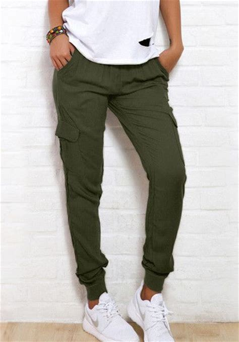 This rifle green cargo joggers features elastic mid waist in tapered style together with a ...