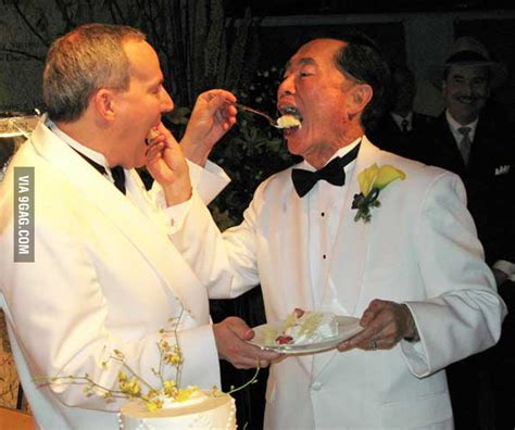 george takei   husband eating wedding cake