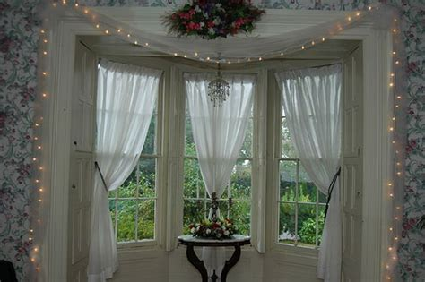 bay window curtain configuration dining room inspiration