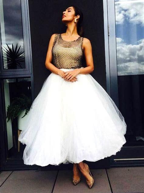 Malaika's tutu skirt or Radhika's black dress? - Rediff ...