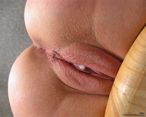 Shaved Redhaired Teenie Using A Dick