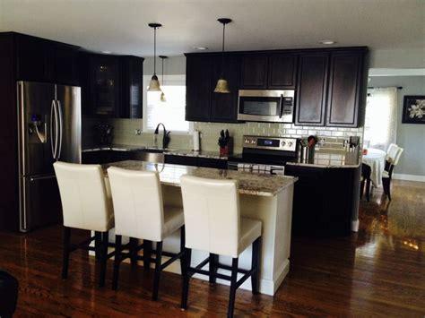 dark cabinets white island glass tile backsplash
