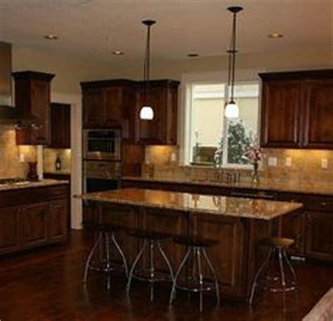 light for the kitchen merillat tolani maple staggered cabinets in kona denova 6984