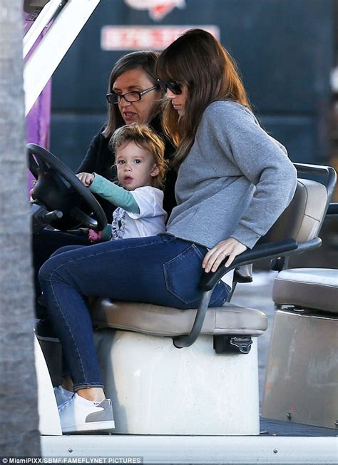 actress jessica of total recall crossword clue jessica biel takes son silas for a spin in a golf cart on