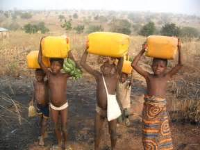 African Children Carrying Water