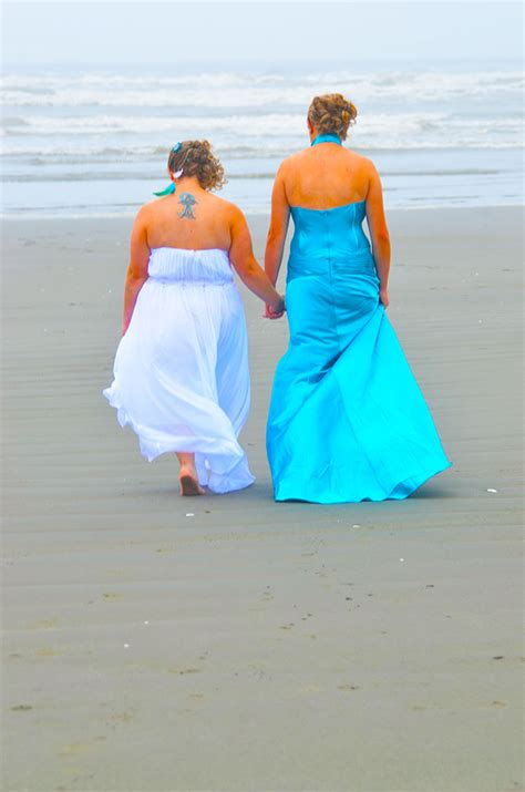 weddings lesbian sea beach wedding lgbt washington wa couple gay walking same return constance officiant sand