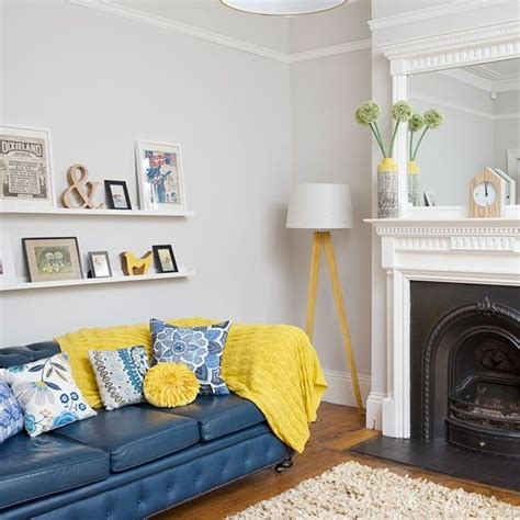 Decorating Ideas For Living Room With Blue Sofa by Best 25 Yellow Living Rooms Ideas On Yellow