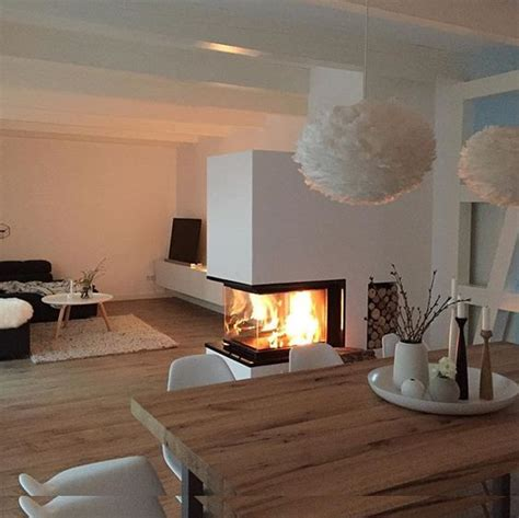 lovely fireplace in the middle of the room living room