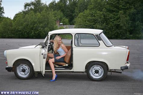 cute girl driving an east german veb sachsenring trabant 601
