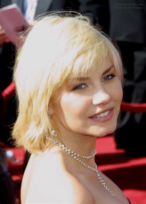 elisha cuthbert hairstyle  covers  neckline
