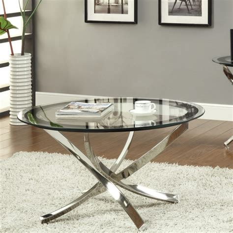 While decorating a round coffee table, many people suggest grouping objects into a triangular shape. Torrin Round Cocktail Tables | Coffee Table Ideas