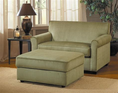 Green Loveseat With Stripped Pattern And Rectangle Ottoman