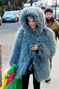 Pixie Keeps Warm In Monstrously Big Blue Coat Pixie