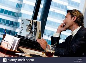 a model poses as a smug hedge fund manager on the phone ...