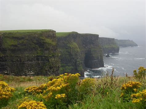 244 Peer Out From The Edge Of The Cliffs Of Moher In