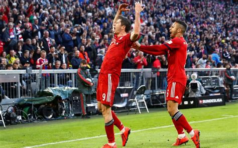 bayern dortmund bayern munich top of bundesliga with devastating 5 0 win