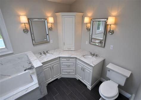 custom master bathroom  double corner vanity tower cabinet wall sconces toilet  built