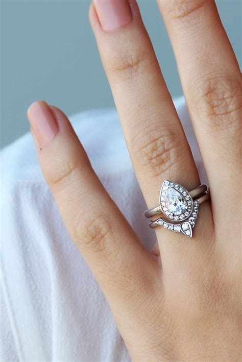 pear shaped engagement ring with matching side