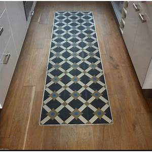un quottapisquot de carreaux de ciment au milieu du parquet With mélange parquet carrelage