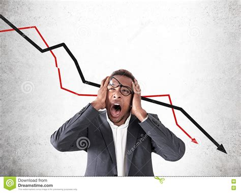 African American Man And Stock Market Failure Stock Image
