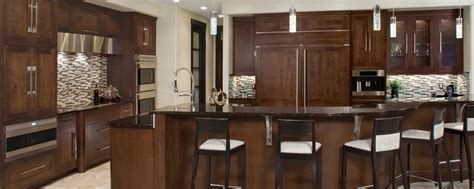 quaker door style kodiak stain  maple huntwood cabinets