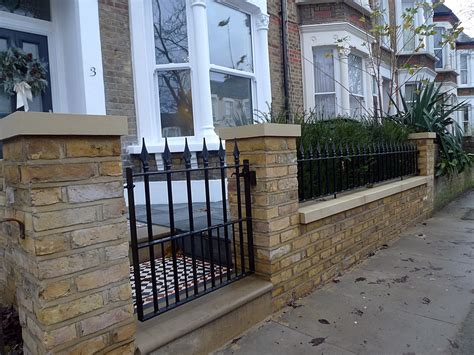 brick wall with gate entrance london garden design