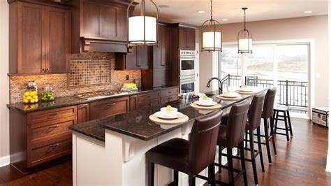 kitchen island cherry cherry cabinets with a mocha finish on the perimeter and 1868