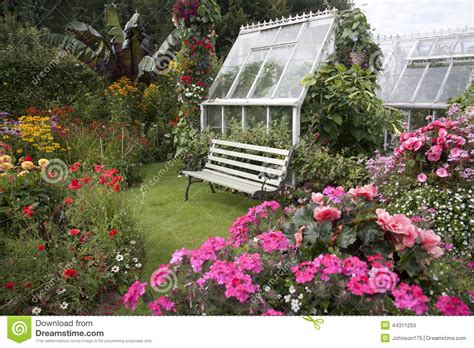 Cottage Garden Seat & Greenhouse Stock Photo  Image 44311250