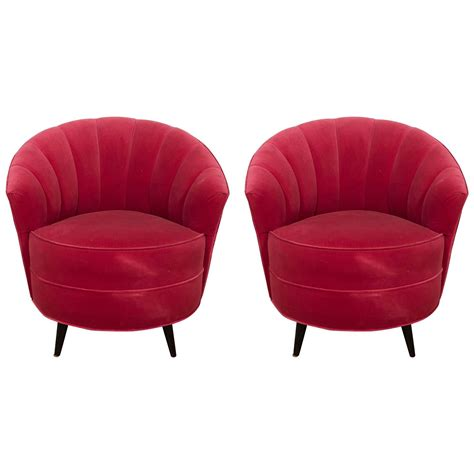 pair of 1960s velvet channel back swivel chairs for