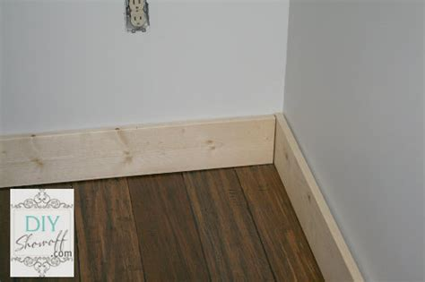 Family Room Baseboard {DIY installation and caulking