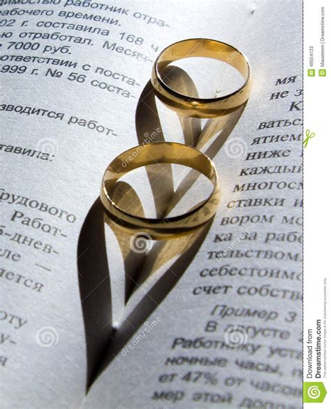 wedding ring on a book with a shadow in the shape stock