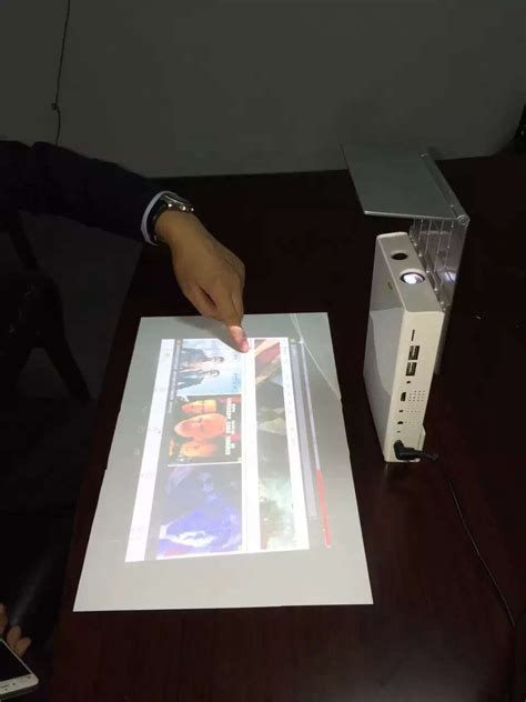Touch Mini Projector,Work As A 16inch Pad & 200inch