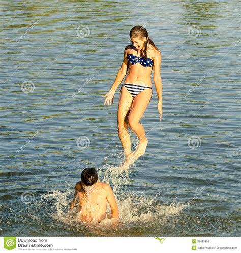 Teenage Girl Jumping Into The River Stock Image  Image Of