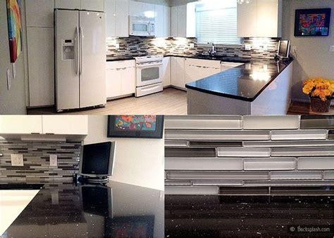 kitchen countertops and backsplash white kitchen cabinets black galaxy countertop gray glass