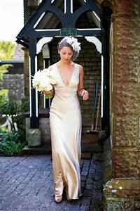 a 1940s inspired silk wedding dress for a relaxed and With 1940s inspired wedding dresses