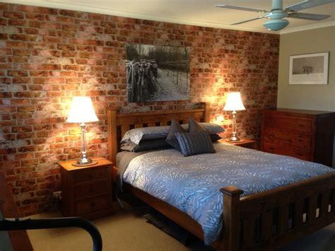 brick wallpaper accent wall  bedroom rustic bedroom