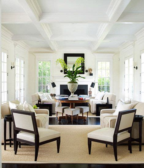 Large Living Room With 2 Seating Areas by Layout With Center Table Dividing The Two Seating