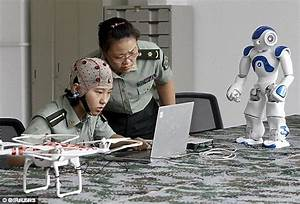 China reveals deadly rifle-wielding robots to combat ...