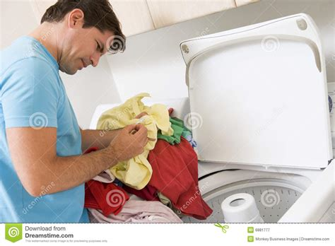 doing laundry by man doing laundry royalty free stock photography image 6881777
