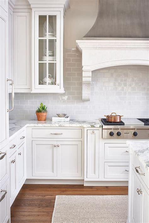 White and Gray Kitchen with Light Gray Mini Subway Tiles