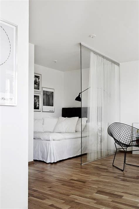 small studio apartment ideas glass wall and curtains