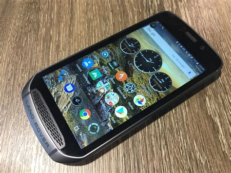 rugged hands   land rover explore smartphone