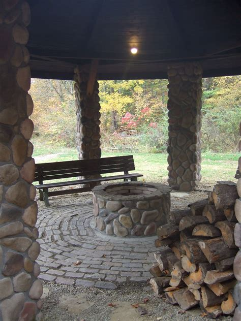 covered fire pit area  enjoy  campfire  year  picture    outdoor living space